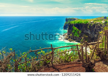 Bali seascape with huge waves at beautiful hidden white sand beach. Bali sea beach nature, outdoor Indonesia. Bali island landscape. Summer holidays at ocean beach. Travel vacation in Indonesia beach #1209211426