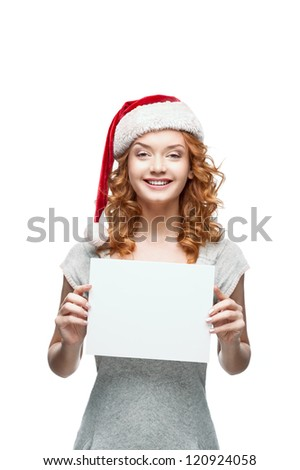young casual happy smiling caucasian girl in santa hat looking at camera and holding sign #120924058