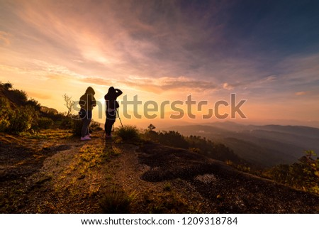Two photographers take a picture of the sunrise at Doi Inthanon, Chiang Mai, Thailand. #1209318784