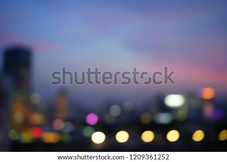 Blurred background of cityscape and blue sky after sunset, twilight time with silhouette building and colorful bokeh defocused lights. (selective focus, space for text, article layout) #1209361252