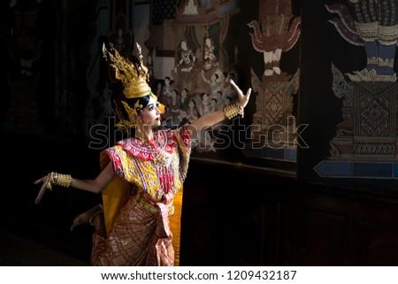 Thailand traditional or cultural dance in Thai costume. Thai beautiful girl is dancing called Nang Ram, it is noble Thai art of elegance. #1209432187