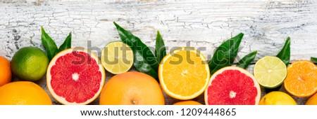 Fruits citrus background. Orange, grapefruit, lemon, lime, tangerine. Assorted citrus fruits with leaves. Long web format #1209444865