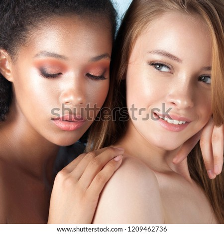 Caucasian and african teen girls close-up. Skin care and makeup. Mixed race beauty portrait #1209462736