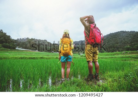 Lover asian man asian women travel nature Travel relax Walking a photo on the rice field in rainy season in Chiang Mai, Thailand #1209495427
