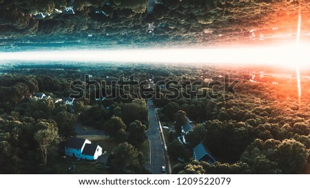 Sunset of a town with flipped and manipulated.