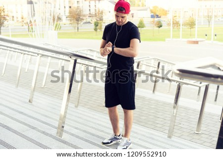 Young man in sports clothing. Urban man prepare to jogging in the city. Working out urban #1209552910