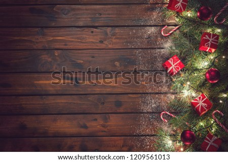 Christmas background with ornaments and gift boxes on the old wooden board #1209561013