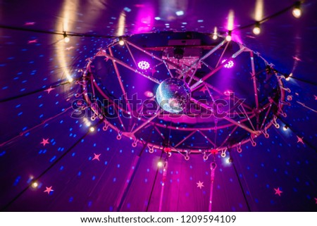 Disco ball under the dome of the circus. Circus illumination. #1209594109