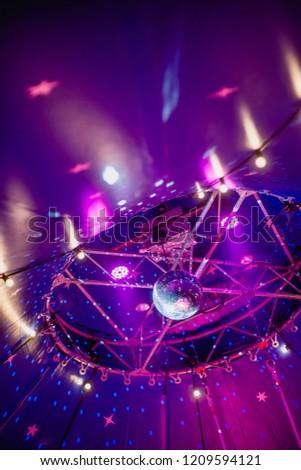 Disco ball under the dome of the circus. Circus illumination. #1209594121
