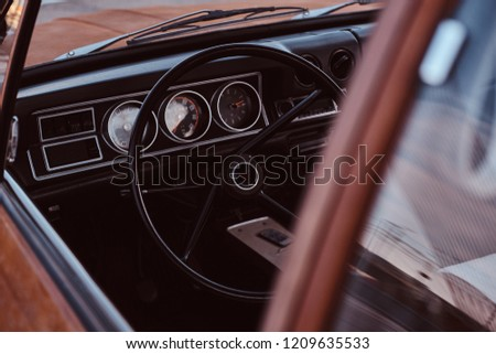 Steering wheel and dashboard. Interior of a restored retro car. #1209635533