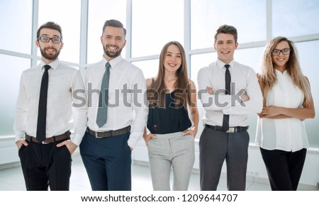 confident business team standing in the office #1209644707