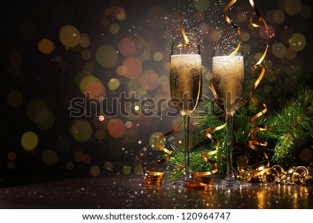 Two champagne glasses ready to bring in the New Year #120964747