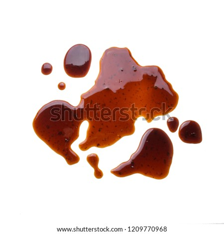 Puddle of tasty soy sauce isolated on a white background #1209770968