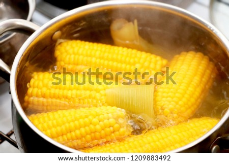 Yellow corn stew in a saucepan. Flavored dinner #1209883492
