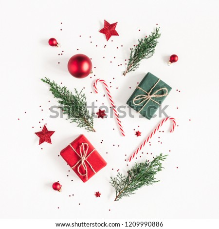 Christmas composition. Gifts, fir tree branches, red decorations on white background. Christmas, winter, new year concept. Flat lay, top view, copy space, square #1209990886