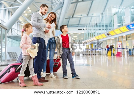 Family and children with luggage in airport terminal fly together on vacation #1210000891
