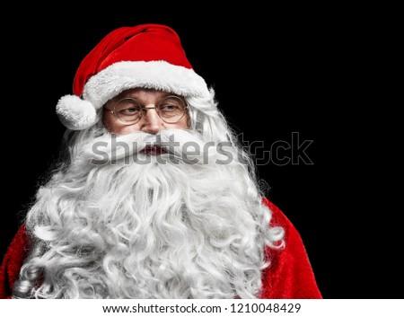 Sad and worried santa claus at studio shot  #1210048429