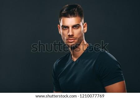 Handsome man posing in studio on dark background #1210077769