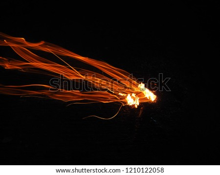 Fire. Burning of paper, Abstract light background, Lighting, Motion blur, Image blur of Fire, Fire motion.