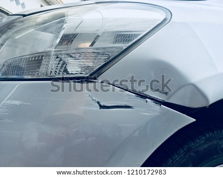 Car scratch at front bumper from road accident. Bad day, car scratch on front bumper from accident. Front of Bronze silver car get damaged by accident on the road. #1210172983
