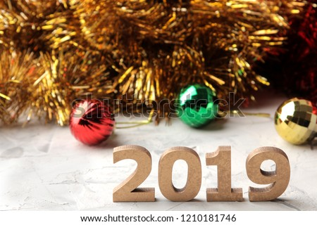 New Year 2019. Christmas. Holidays. Composition with Christmas and New Year garlands, toys and numbers 2019 #1210181746