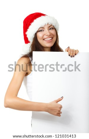 christmas young sexy woman happy smiling and holding empty banner, isolated on white background #121031413