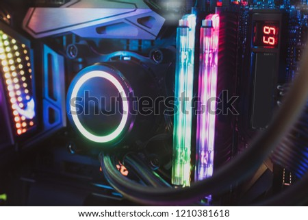 Computer with water cooling system.Inside of air cooled high performance modern.fan and ram memory rgb led light. #1210381618