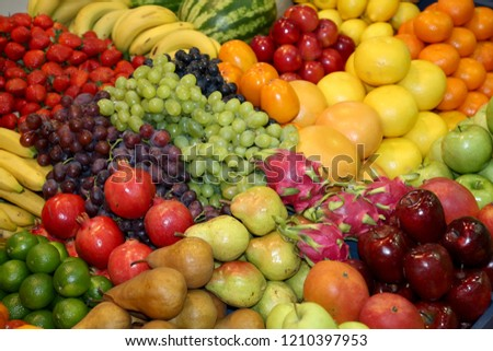 Background from freshly picked apples, pears, bananas, grapes, strawberries, cranberries, lemons, melons, raspberries, currants, blackberries, peaches, gooseberries, apricots, peaches #1210397953
