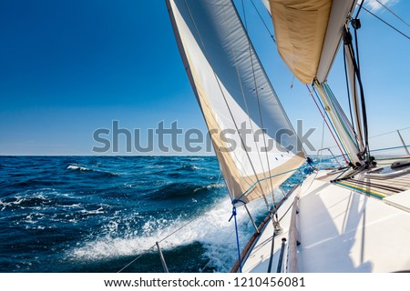 White sailing boat at open sea in sunshine Royalty-Free Stock Photo #1210456081