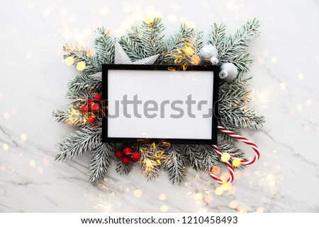 Christmas holiday frame background with xmas tree and xmas decorations. Merry Christmas greeting card, banner. Winter holiday theme. Happy New Year. Space for text #1210458493