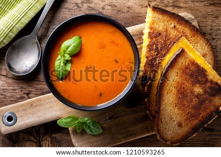 Delicious homemade tomato soup with a grilled cheese sandwich on rye. #1210593265