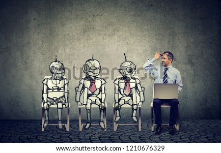 Human vs artificial intelligence concept. Business job applicant man competing with cartoon robots sitting in line for a job interview