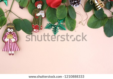 Merry Christmas and decorations with light yellow background. #1210888333