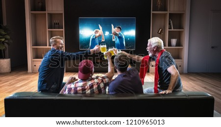 Group of fans are watching a soccer moment on the TV and celebrating a goal, sitting on the couch in the living room. The living room is made in 3D. #1210965013