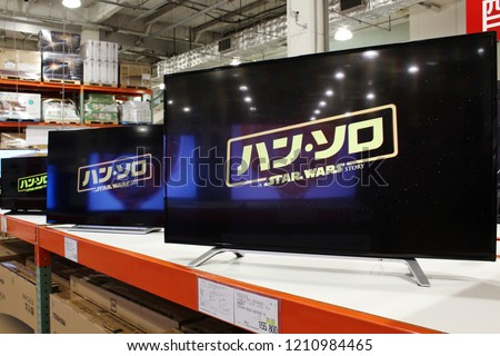 CHIBA, JAPAN - October 18, 2018: Several large 4K TVs on display in a Japanese branch of the American membership warehouse club Costco. #1210984465