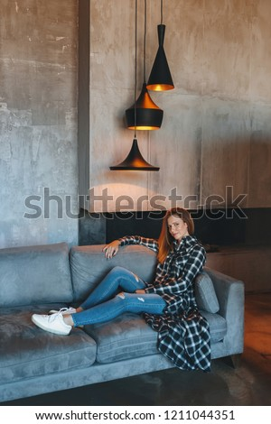 Beautiful girl in casual dress stands in the loft interior.  #1211044351
