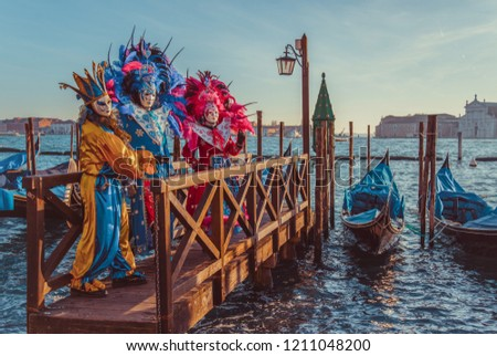 Colorful carnival masks at a traditional festival in Venice, Italy #1211048200
