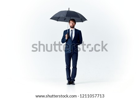 man holds open umbrella in his hand                              #1211057713