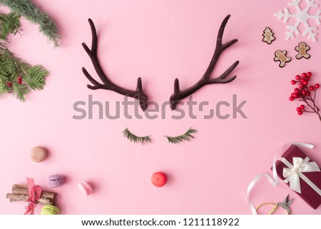 Christmas reindeer concept with presents, decoration, and winter things on pastel pink background. Minimal winter holidays idea. Flat lay top view composition. #1211118922