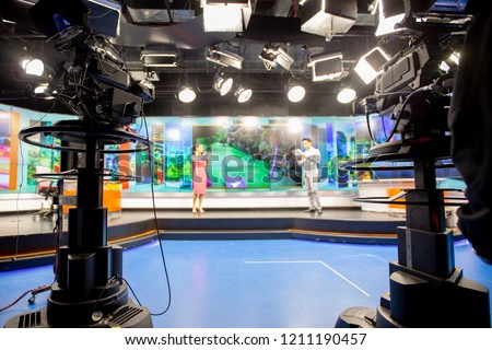 Camera in studio are broadcasting journalists reading news.Blur background have journalist or reporter. #1211190457
