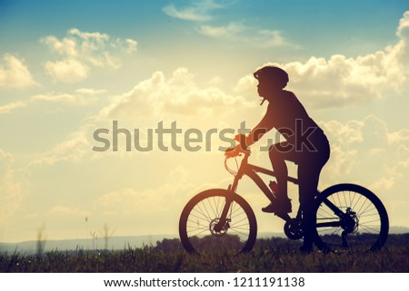 Silhouette Young man of cycling on sunset background #1211191138