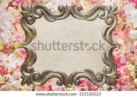 Romantic Vintage Photo Frame with flowers around the frame and grunge space in the middle for your text