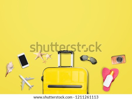 Yellow suitcase with traveler accessories on yellow background. travel concept #1211261113