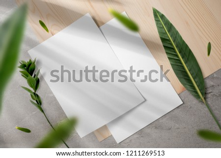 Elegant stationery mockup set, letterhead, with floral shadows overlays, floral elements, top view, on wooden background. #1211269513