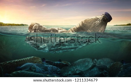Plastic water bottles pollution in ocean (Environment concept) #1211334679