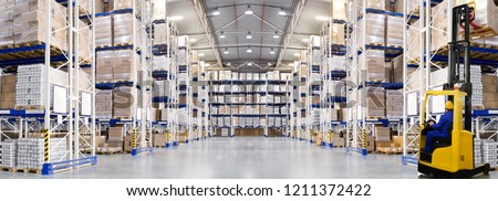 Huge distribution warehouse with high shelves and forklift. Bottom view. Royalty-Free Stock Photo #1211372422
