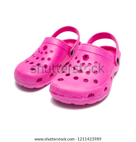 pink pair of professional ventilated work clogs isolated over white #1211423989