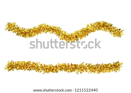 Christmas gold tinsel for decoration. White isolate #1211522440