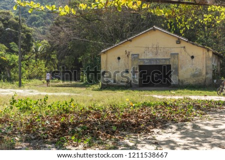 Landscape of abandoned wharehouse on the beachfront in Vila Dois Rios, a small village behind Dois Rios Beach, Ilha Grande, Costa Verde, south Rio de Janeiro, Brazil #1211538667