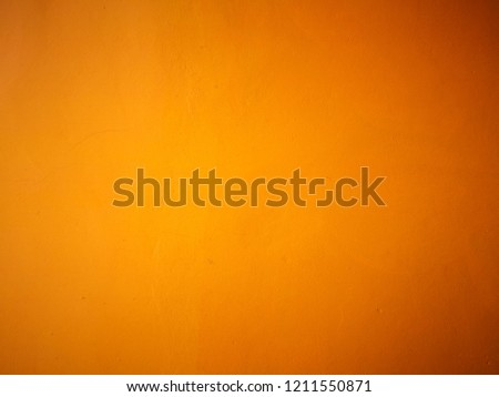 Abstract bright yellow color cement wall colorful background.